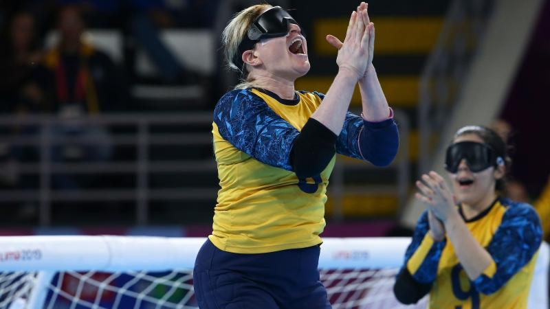 female goalball players celebrating