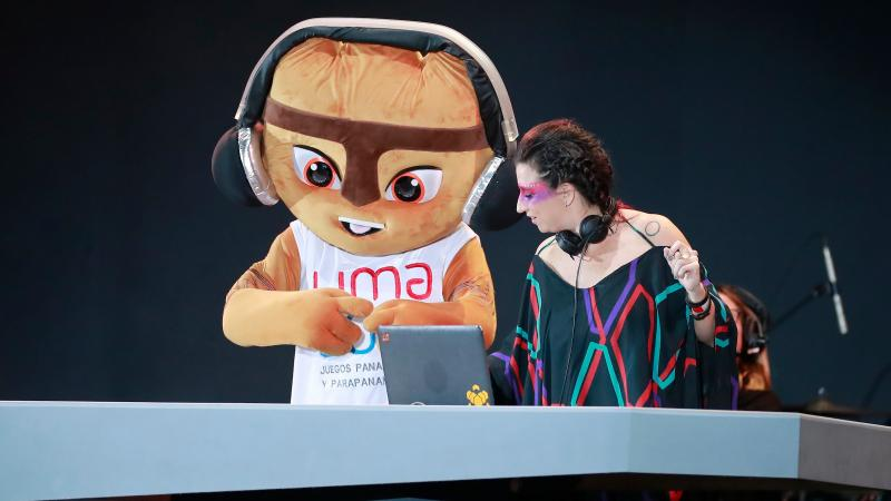 a giant mascot and a DJ dance on the stage