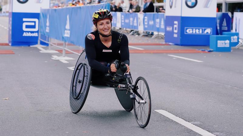 A female wheelchair racer on the streets of Berlin