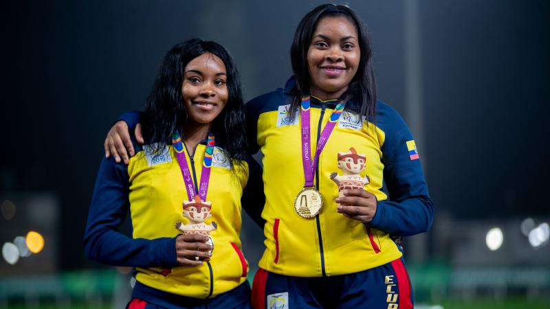 Ecuadorian Poleth Mendes stands on the podium with the gold medal hanging around her neck