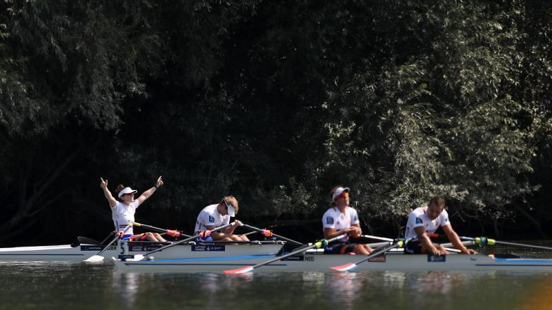 British rowing crew celebrates while Dutch rowing crew looks disappointed