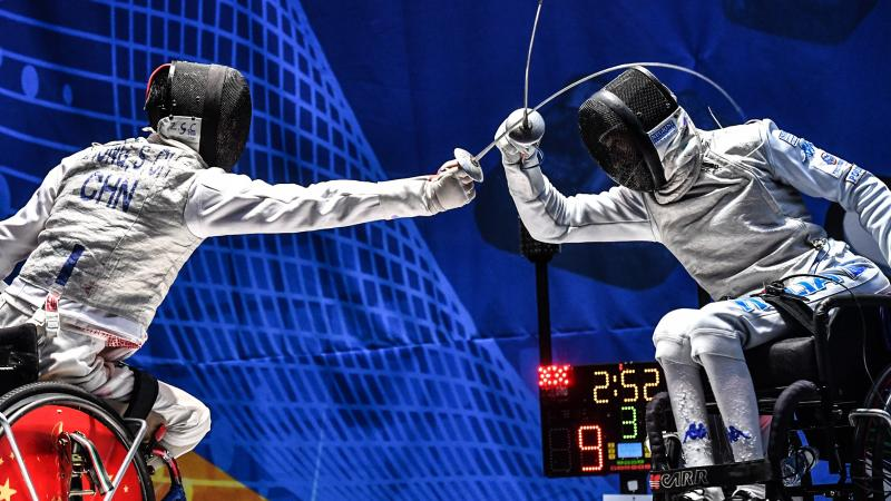 Two wheelchair fencers battling