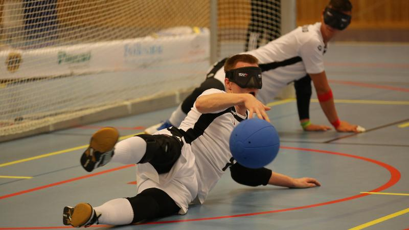 German goalball player throws himself to the floor to catch the ball