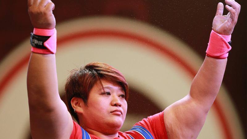 Chinese Taipei's powerlifter Tzu-Hui Lin raises her arms