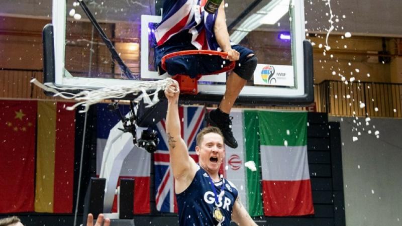 Great Britain players celebrate the Wheelchair Basketball World Championships title in Hamburg