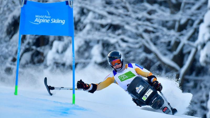 A female sit-skier competing