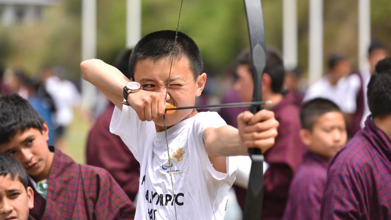Boy tries Archery during Paralympic Day in Bhutan
