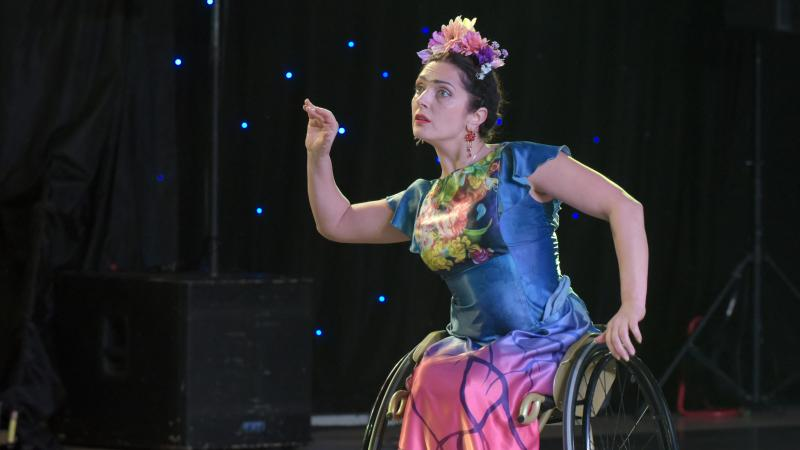 Woman in wheelchair performing in Para dance