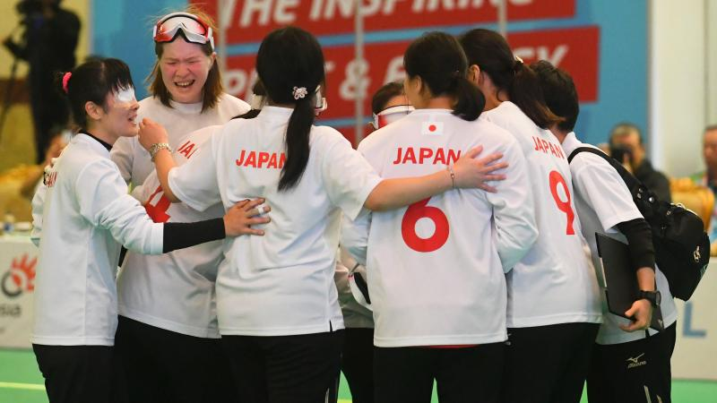 Japanese female goalball players embracing
