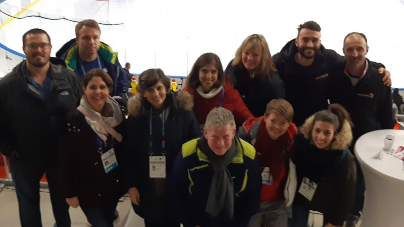 Group  photo of meeting members inside an ice arena
