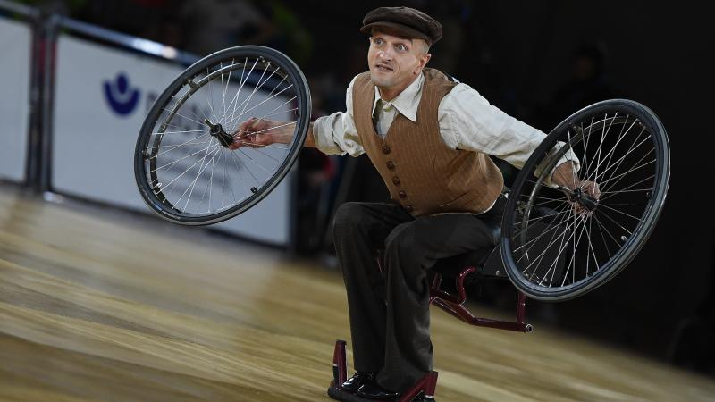 Male Para dance removes wheels in wheelchair