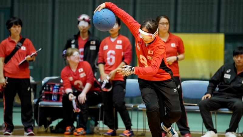 Japanese female goalballer about to throw the ball