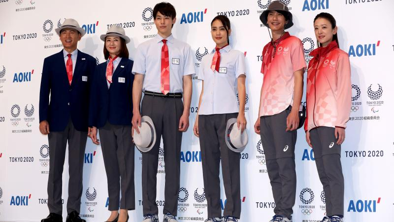Models posing with Tokyo 2020 technical officials uniforms