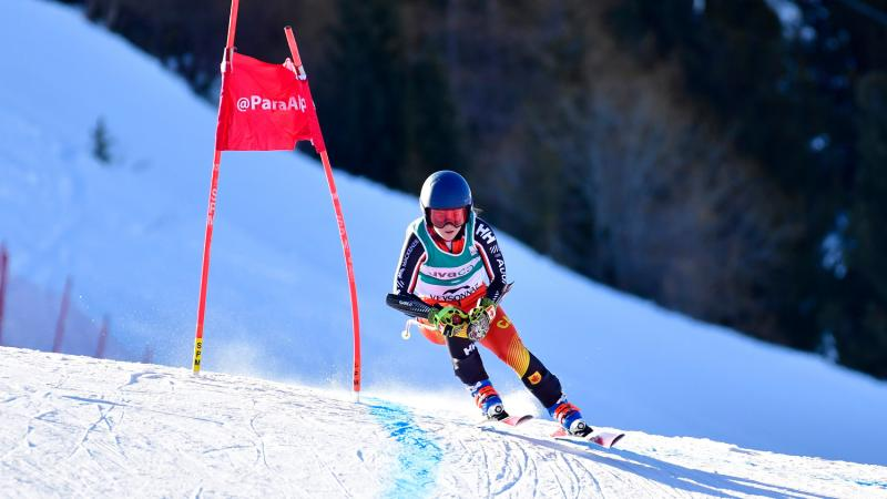 Female skier rides down the course
