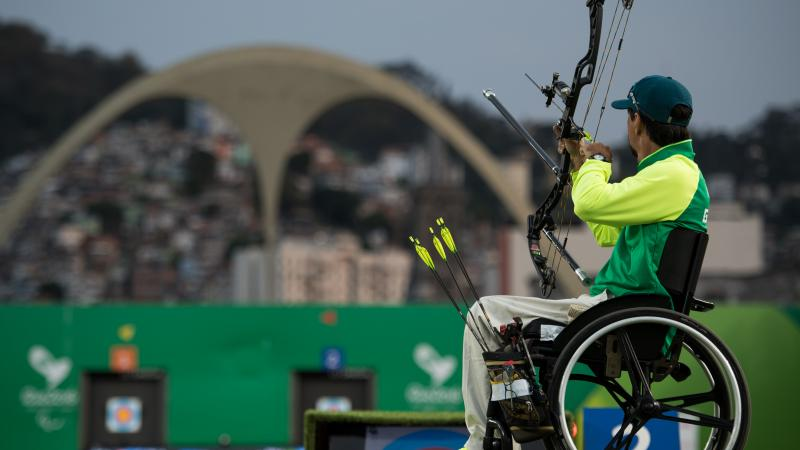 Brazilian male archer in his wheelchair aiming at the target