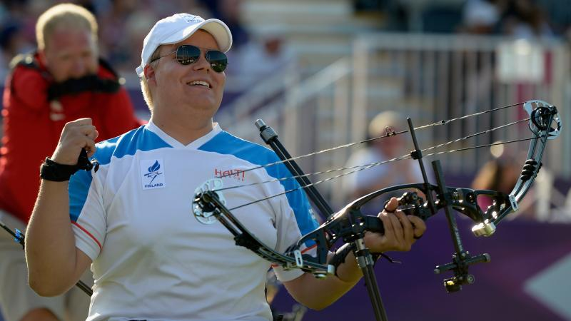 Finnish male archer celebrates after winning Paralympic gold
