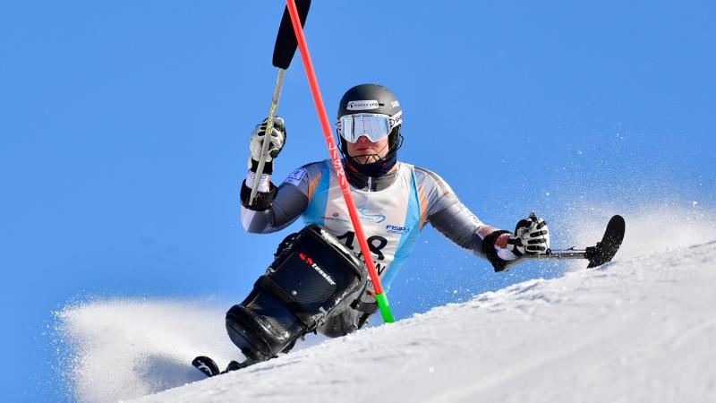 Male sit-skier competes in the slalom