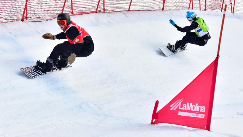 Two male Para snowboarders competing