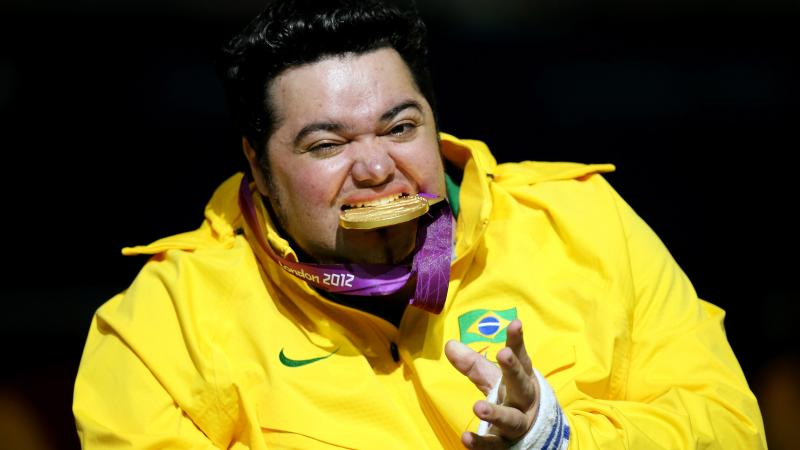 Male boccia player bites his Paralympic gold medal