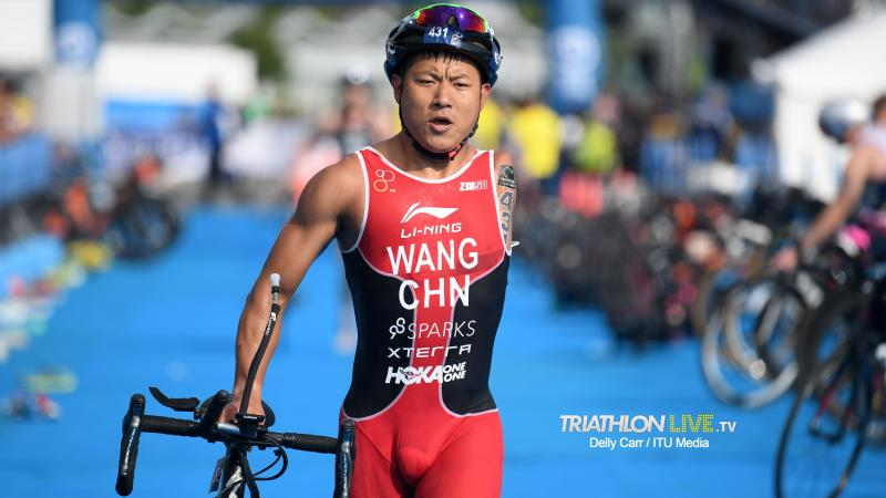 Chinese male with left arm amputation transitions to bike segment of triathlon
