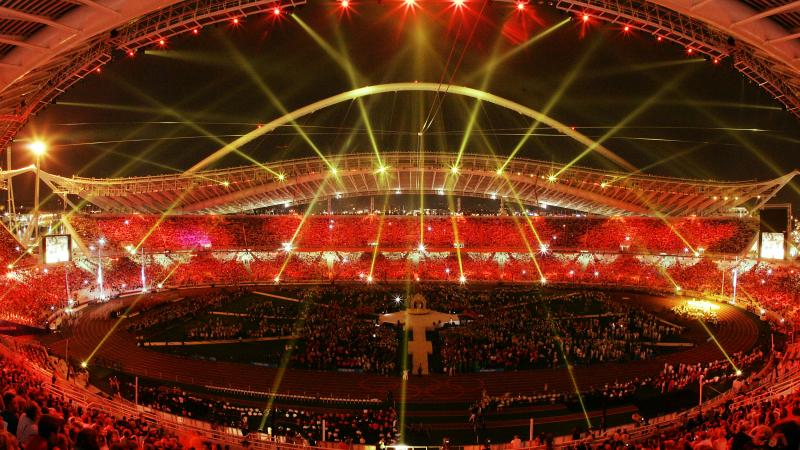 ATHENS - SEPTEMBER 28:  The lights at Olympic Stadium turn red symbolizing the handover of the Paralympic games to Beijing during the closing ceremonies for the 2004 Paralympic Games September 28, 2004  in Athens, Greece. (