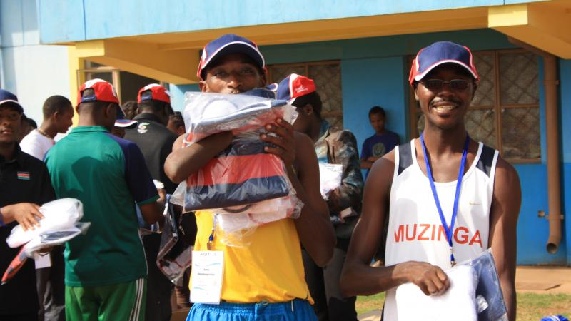 athletes holding packs from Atos