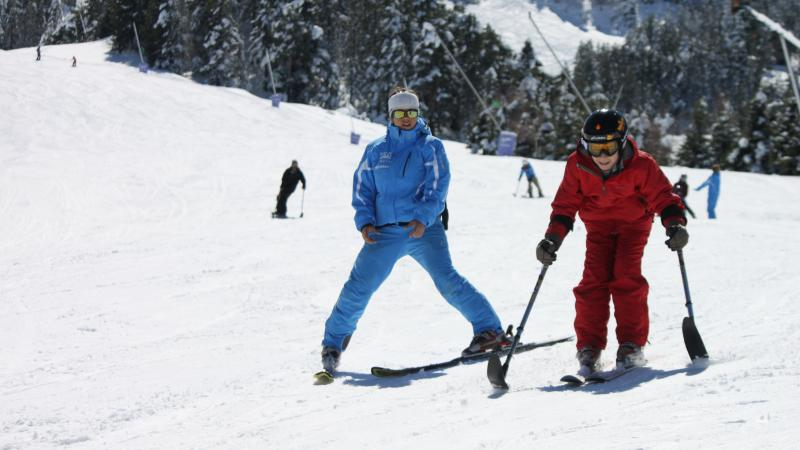 boy skiing with coach