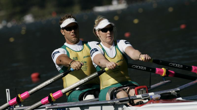 A picture of 2 people rowing together
