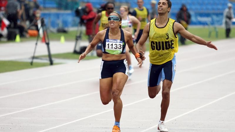 Terezinha Guilhermina running with guide