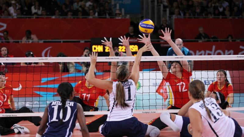 A picture of women playing Sitting Volleyball