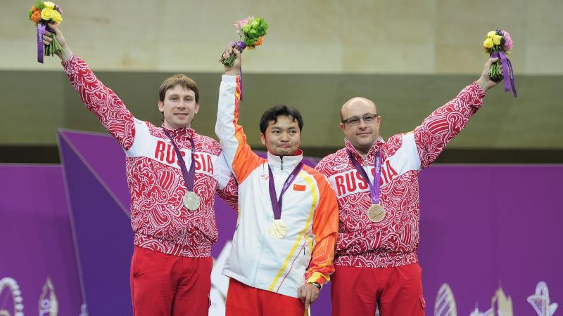 Li Jianfei wins shooting gold