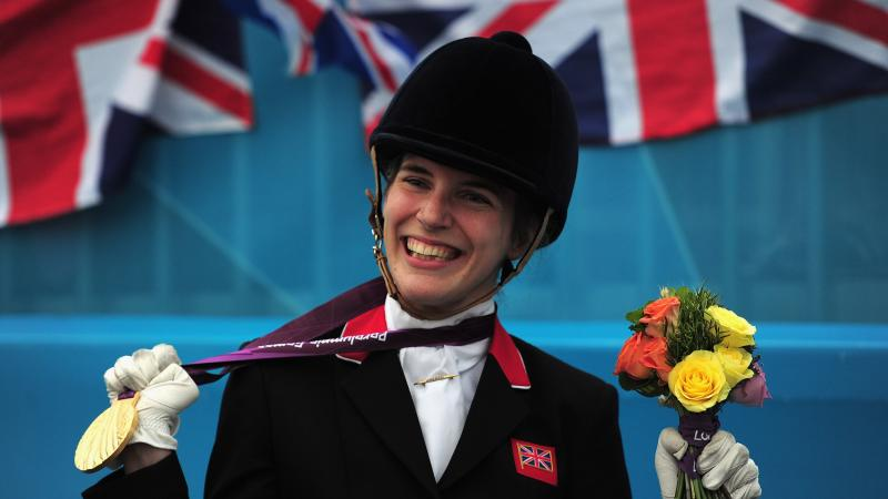 Sophie Christiansen holding gold medal