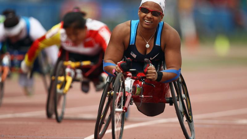A picture of a woman in wheelchair celebrating her victory
