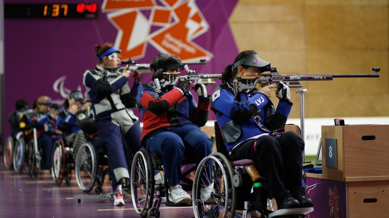 Women shoot under the backdrop of the London 2012 Paralympic games logo during the Women's R8-50m Rifle 3 Positions-SH1 final