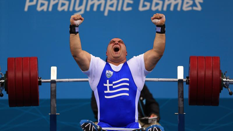 Pavlos Mamalos of Greece reacts with intense joy as he competes in the Men's -90 kg Powerlifting event.