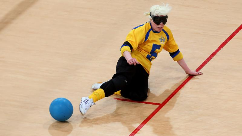 A picture of woman playing Goalball