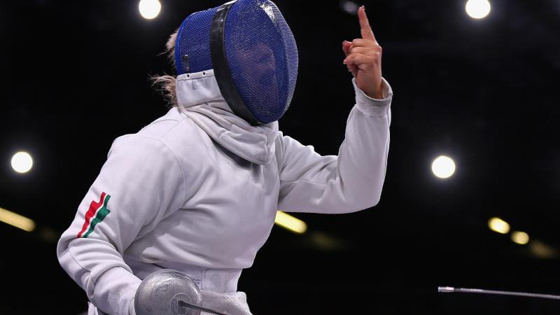 A picture of a Wheelchair Fencer celebrating her victory