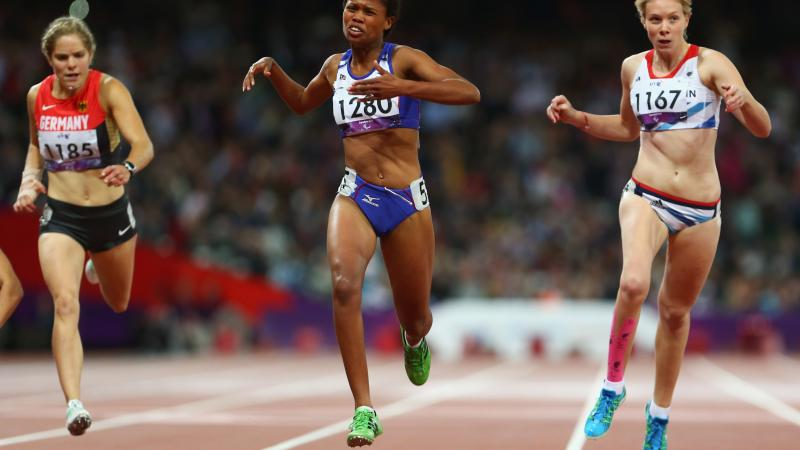 A picture of three women running during an athletics event