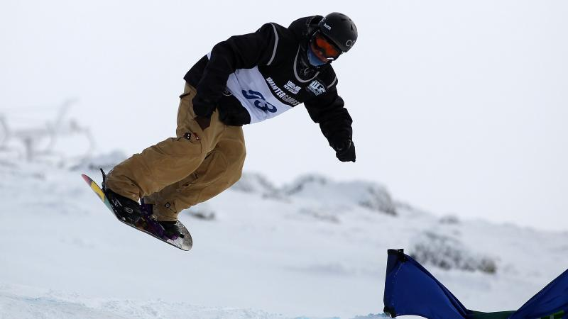 A picture of a man practising snowboard