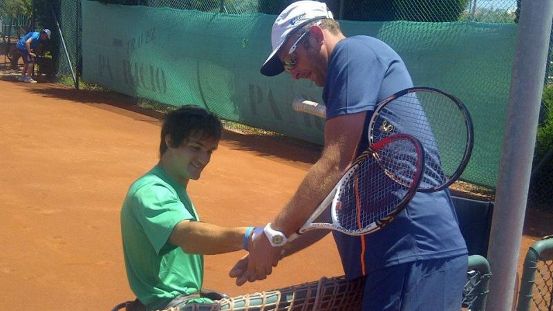 Gustavo Fernandez works with coaches at a ITF  workshop in Turkey