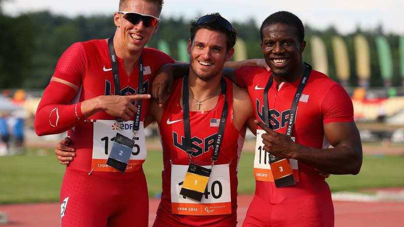 Three members of USA's athletics team - Jarryd Wallace, David Prince and Jerome Singleton - pose for a photo.