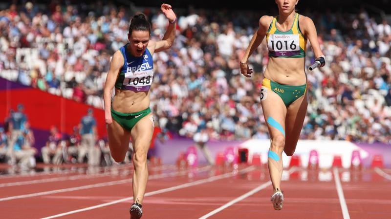 Sheila Finder, Brazil, and Carlie Beattie, Australia, in the women's 100m T46 heat at the London 2012 Paralympic Games.