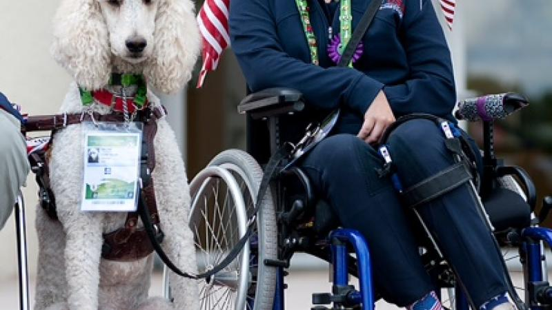 US para-equestrian rider Sydney Collier with service dog Journey.