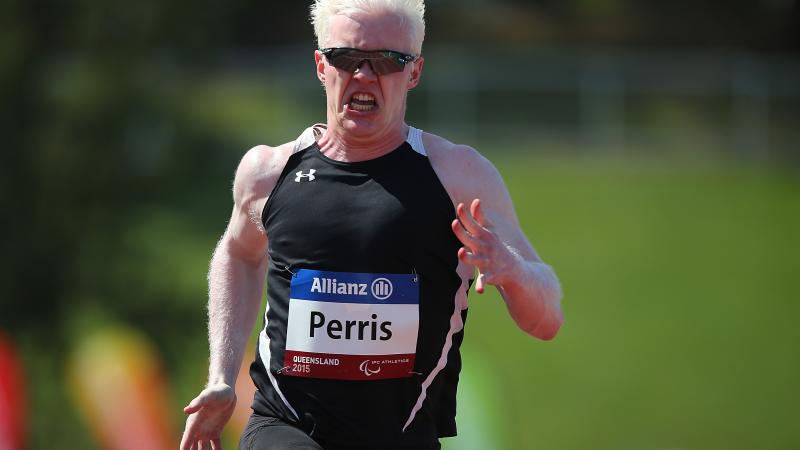 Chad Perris runs in the IPC Athletics Grand Prix Ambulant 100m heats during the Queensland Track Classic.