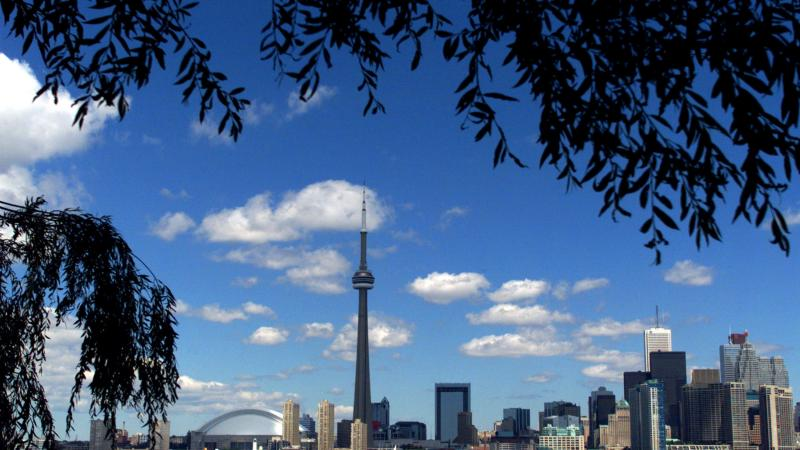 A view of the skyline of Toronto featuring tall buildings and the CN Tower.