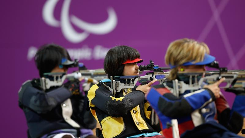 Yoojeong Lee of the Republic of Korea (R) shoots during the Women's R8-50m Rifle 3 Positions-SH1 final at the London 2012 Paralympic Games