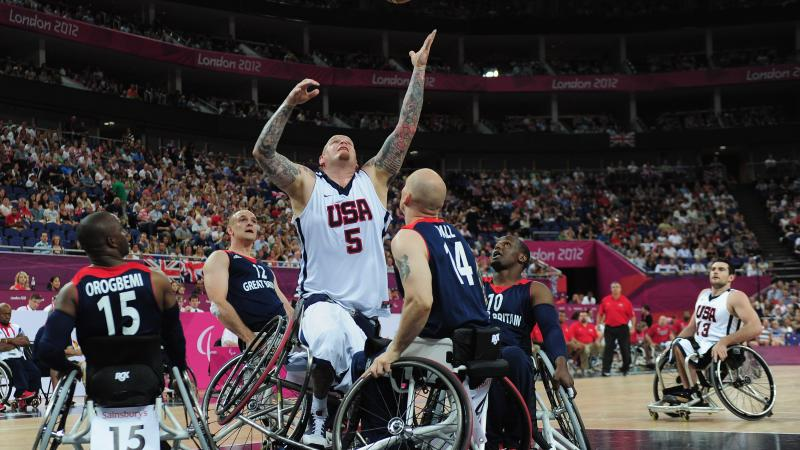 Joseph Chambers of United States reaches for the ball during the bronze medal Wheelchair Basketball match between United States and Great Britain at the London 2012 Paralympic Games