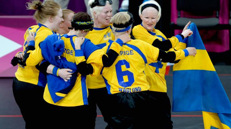 The team of Sweden celebrates after winning their Women's Team Goalball Bronze Medal match against Finland at the London 2012 Paralympic Games.