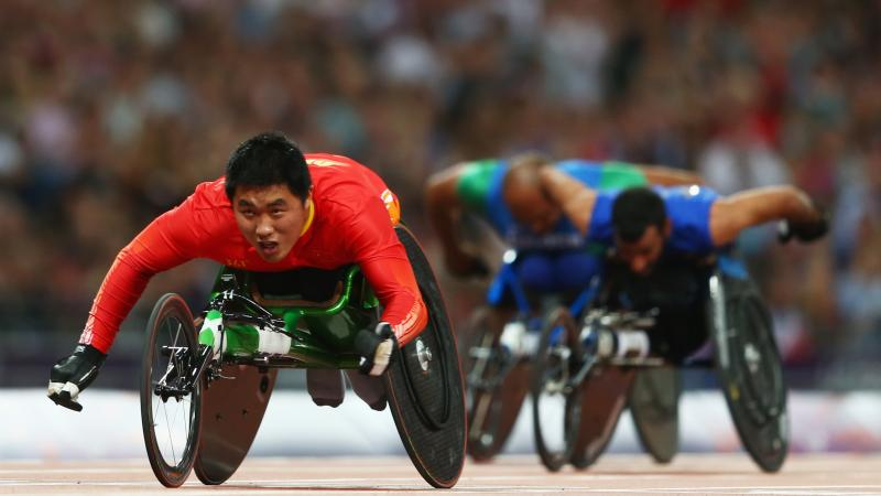 Huzhao Li of China crosses the line to win gold in the Men's 200m T53 Final at the London 2012 Paralympic Games.