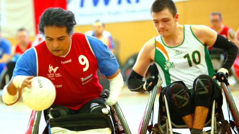 Ireland's Thomas Moylan (10) challenges France's Ryadh Sallem (9) during the IWRF Europe Division B final.